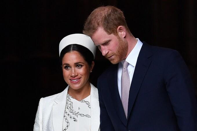 Hoàng tử Anh Harry và vợ Meghan tham gia một sự kiện hoàng gia tại London hồi tháng 3/2019. Ảnh: AFP.