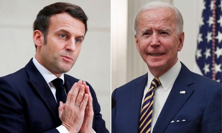 Tổng thống Pháp Emmanuel Macron (trái) và Tổng thống Mỹ Joe Biden. Ảnh: AFP.