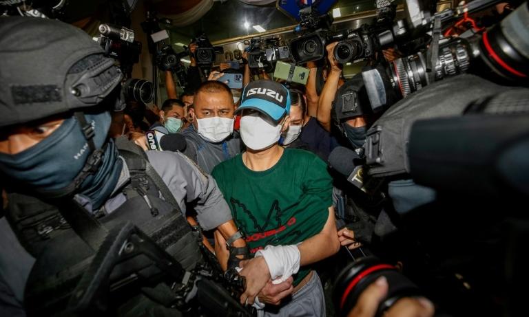 Thitisan Utthanapho (giữa), khi bị bắt hồi tháng 8. Ảnh: AFP