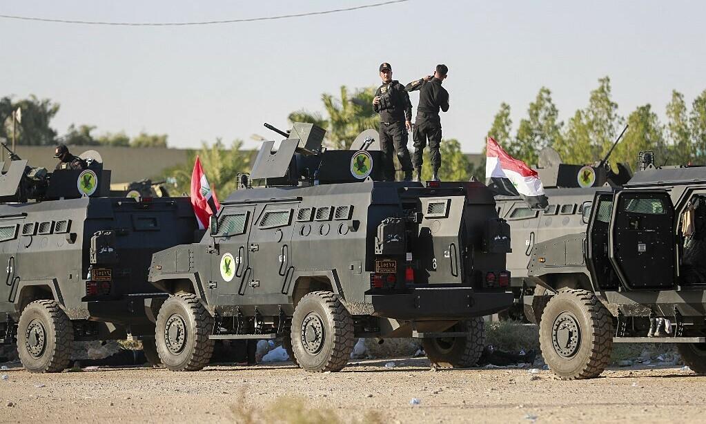 Lực lượng an ninh Iraq triển khai ở thủ đô Baghdad hôm 10/10. Ảnh: AFP.