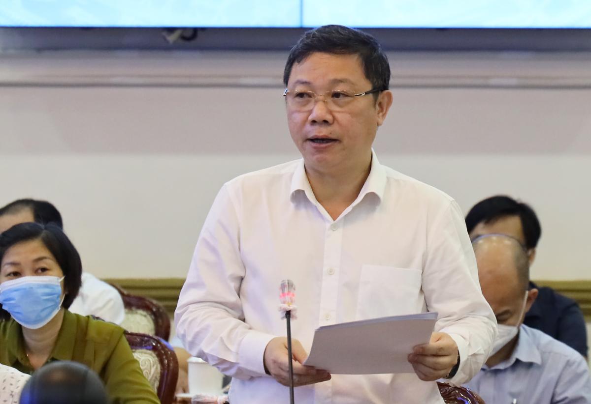 Phó chủ tịch UBND TP HCM Dương Anh Đức báo cáo tại buổi làm viêc. Ảnh: Trung tâm báo chí TP HCM